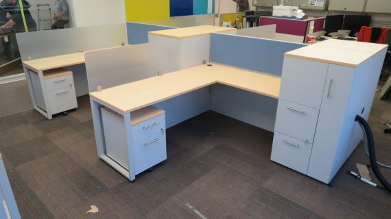 Modern Cubicle Workstation with Metal Legs, Acrylic Screens, and Tackboard