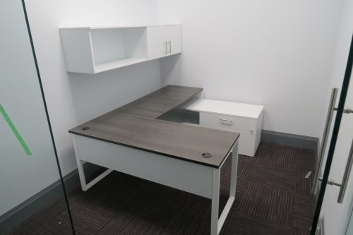 U-Shaped Desk with Metal Base and Wall-Mounted Hutch